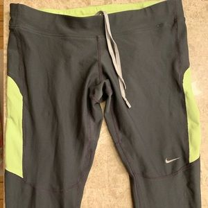 Nike Dri fit leggings .  Grey and Neon size Large